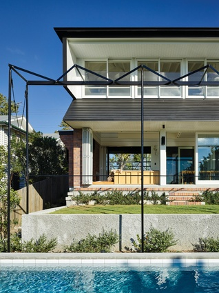 """The """"flared skirt"""" of the upper floor borrows its silhouette from the bay windows that are prevalent in Brisbane."""