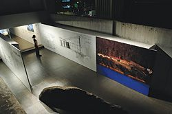 Looking into the lower-level gallery space from above. Image and detailed drawings are of the Boyd Art Centre.
