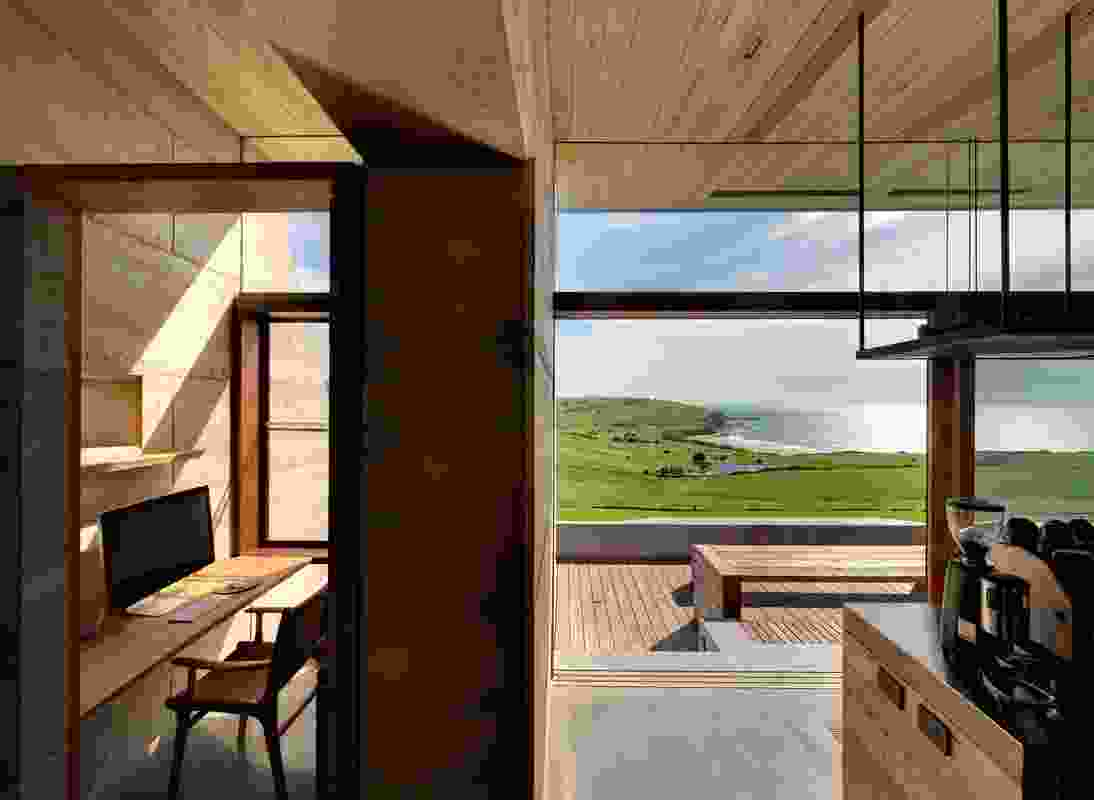 Glazed sliding doors along the northern edge of the communal areas open to an expansive outdoor viewing platform.