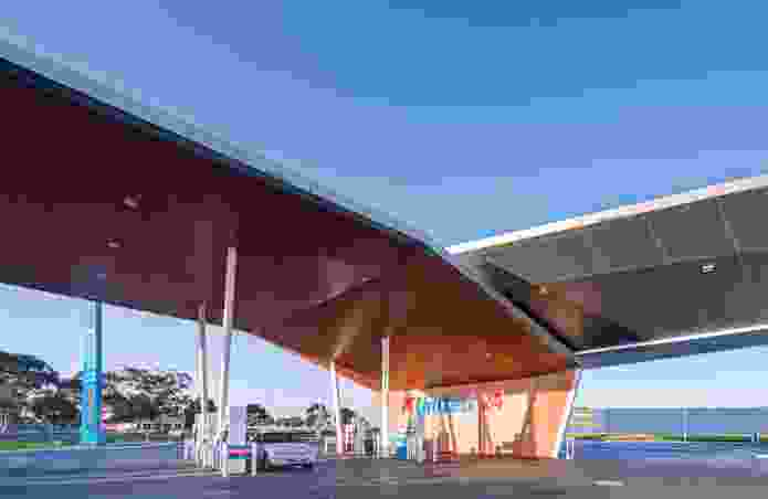The eye-catching geometry of the service station is defined by two unfolding wings, forming blade-like canopies to the petrol bowsers.