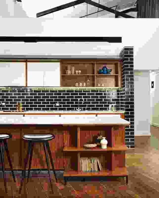 A splashback of glazed bricks in the kitchen.