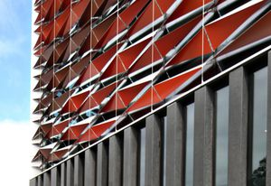 The new BLaKC by FJMT sports a facade of red aluminium sunscreens.