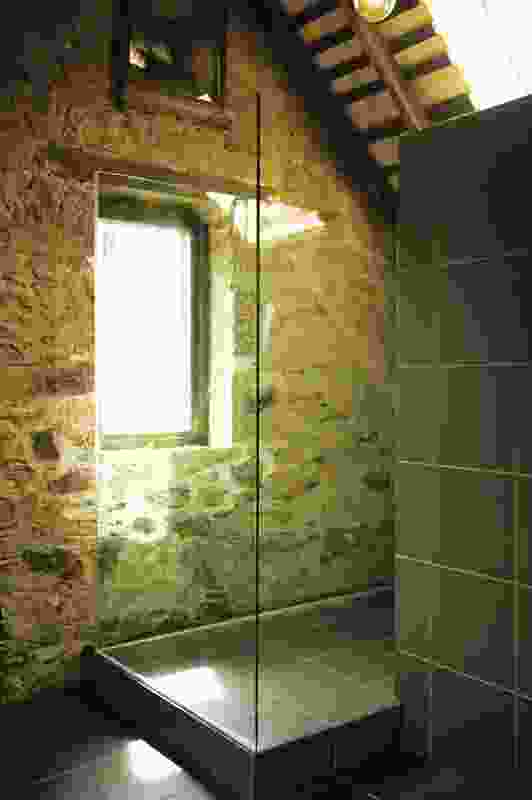 Original stonework has been retained as internal wall surfaces.