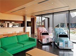 The kitchen and living area. Artwork: Patricia Piccinini, Truck Babies, 1999. Image: Dianna Snape
