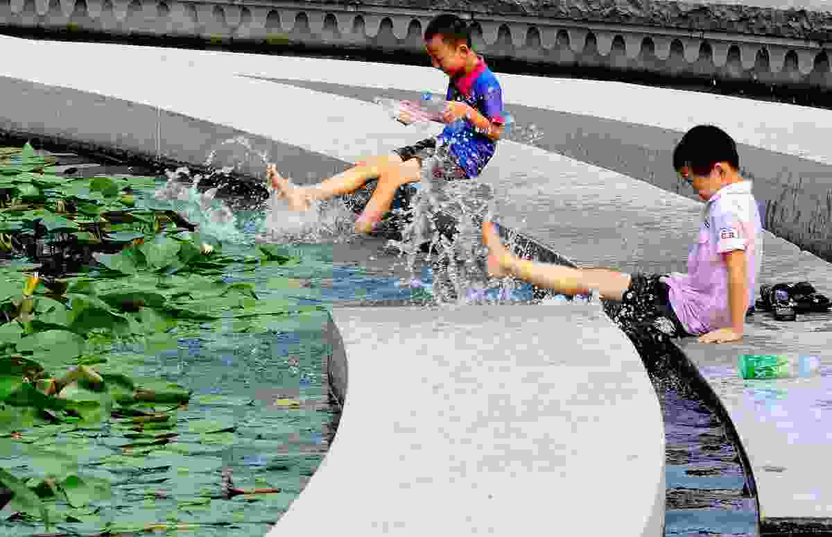 Children splashing in water, Zhangjiagang Town River Reconstruction by Botao Landscape.