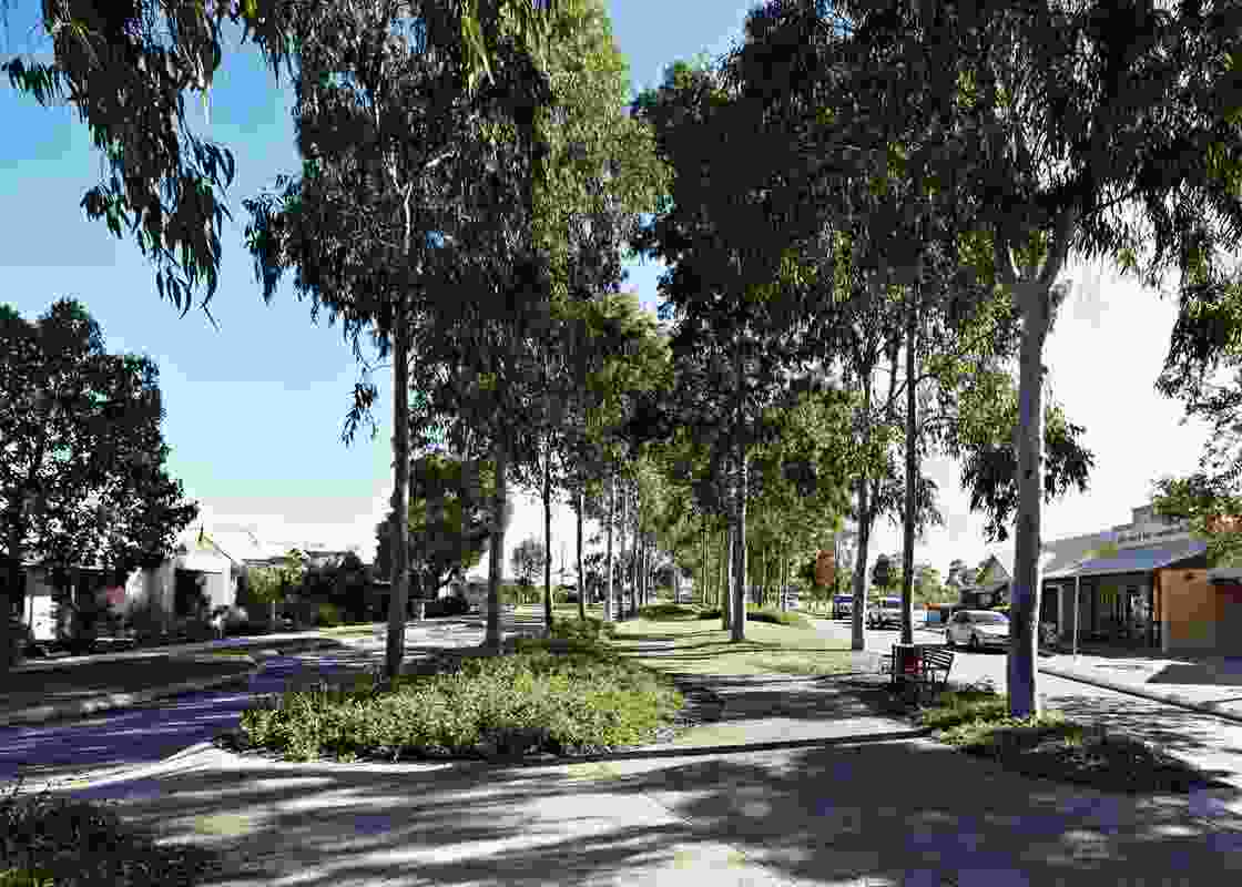 A path leads between the housing and businesses on Coolamon Boulevard.