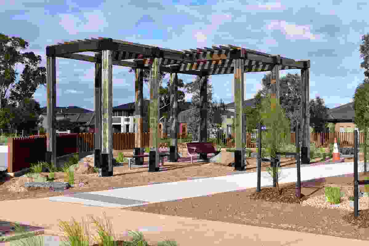 The park includes cantilevered pergola structures.