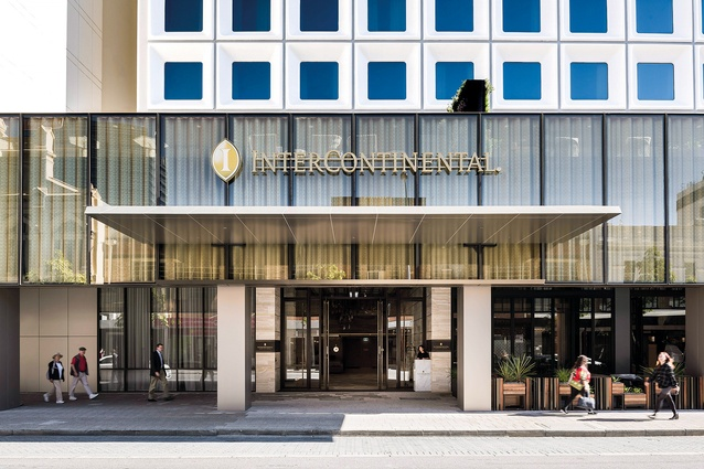 The facade features a curtain-like gold metallic screen that imparts a new gravitas to the building's main entry.