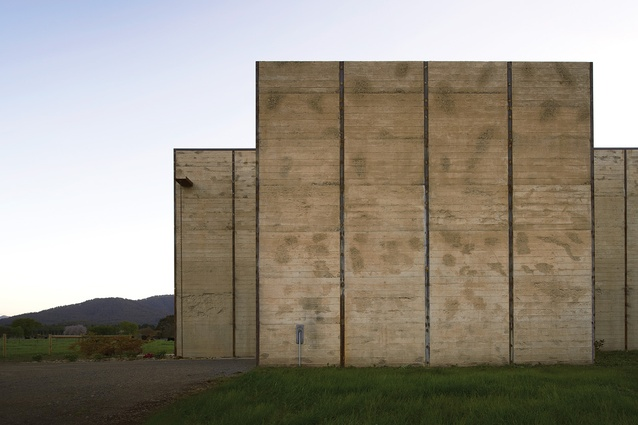 Poured on site, the house's concrete walls were inspired by a rammed earth tobacco kiln on the property.
