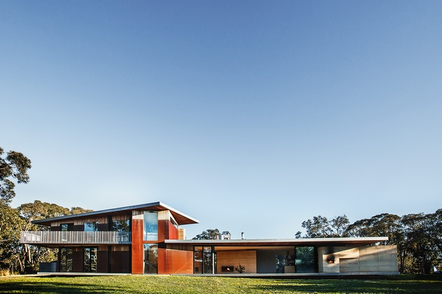 The main anchoring wall is rammed earth, Corten steel encases the stairwell, the first floor is clad in silvertop ash shiplap, while supports, balustrading and fascias are  galvanized steel.
