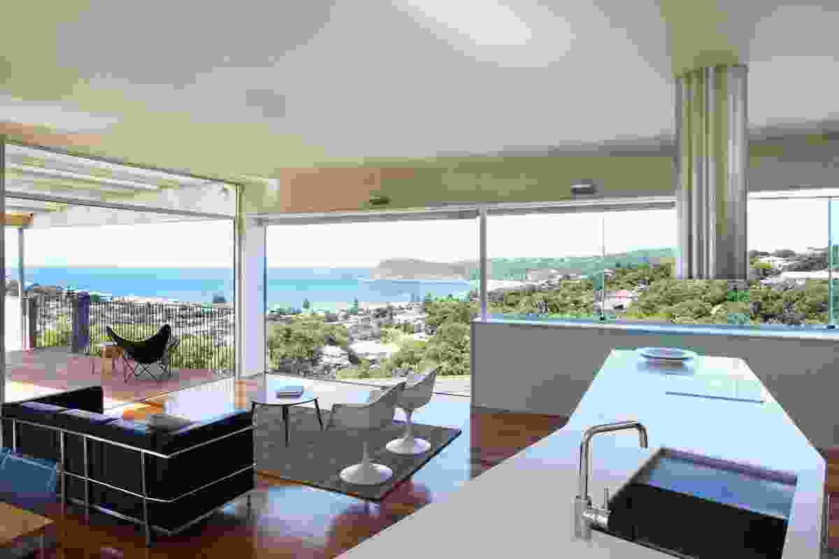 The upstairs living space tilted south to the ocean view; low interior walls screen from neighbours.