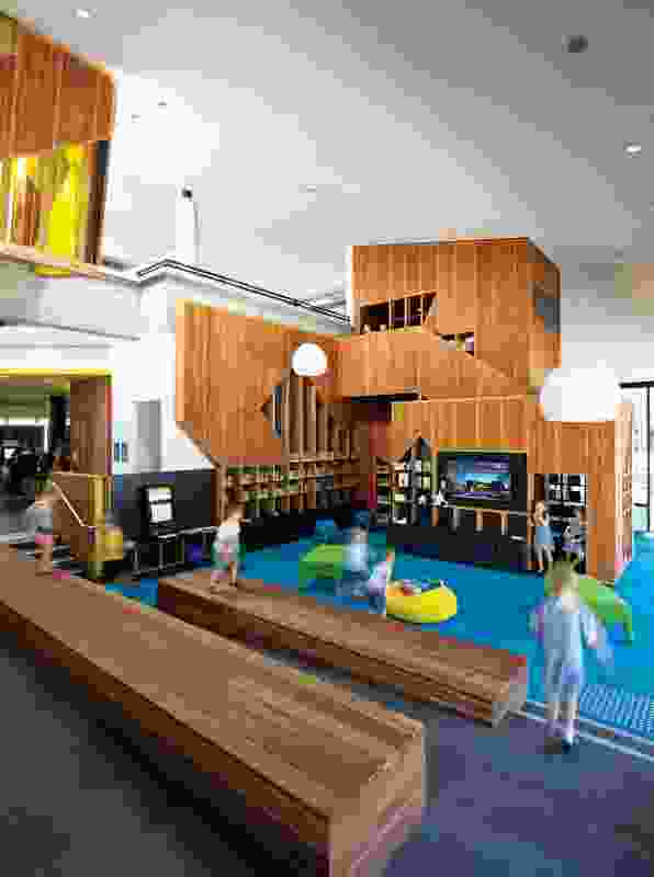 The children's area includes a tower containing a cubbyhouse-like reading room.