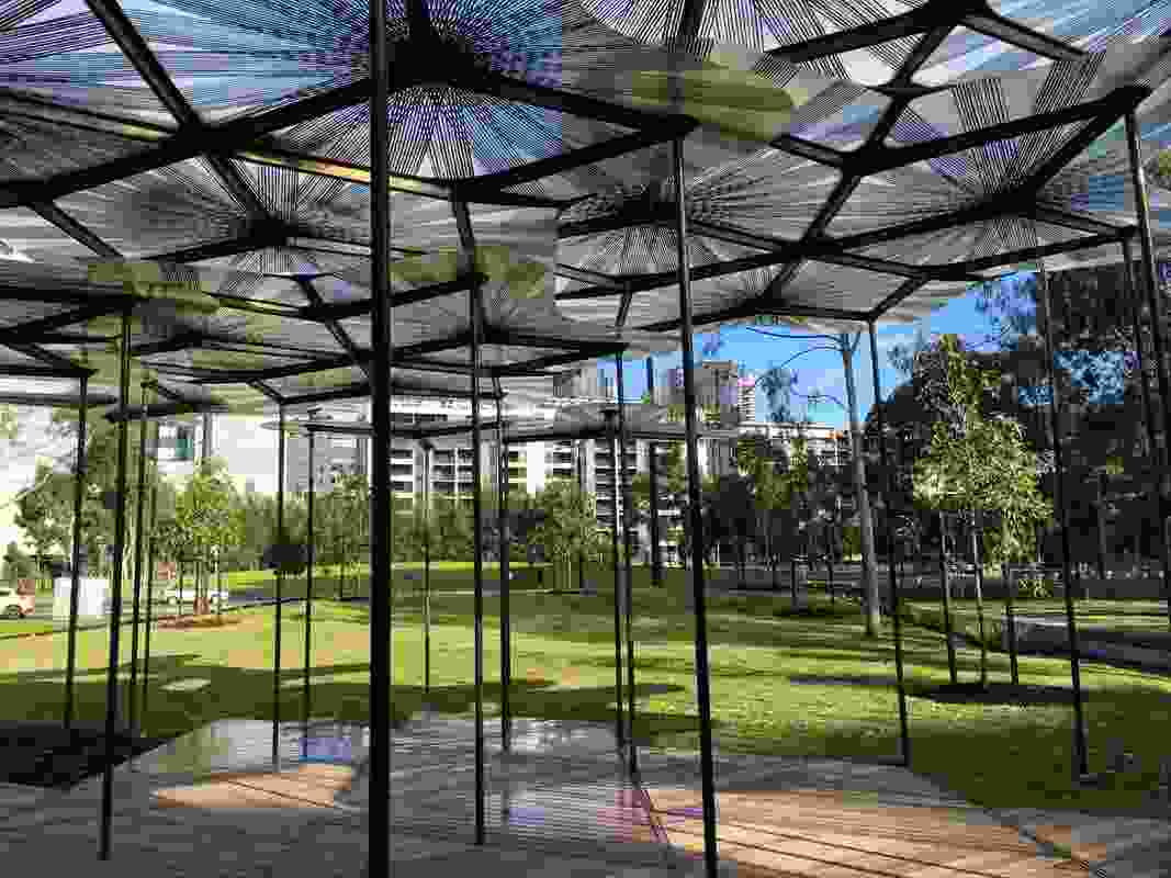 AL_A's 2015 MPavilion is seen close close-up at its new home in Docklands Park, designed by landscape architecture firm MALA.