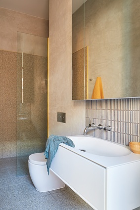 A new bathroom continues the muted palette of materials and colours seen in the main living areas.