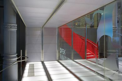 High-tech materials such as metal and glass sit alongside heritage columns.