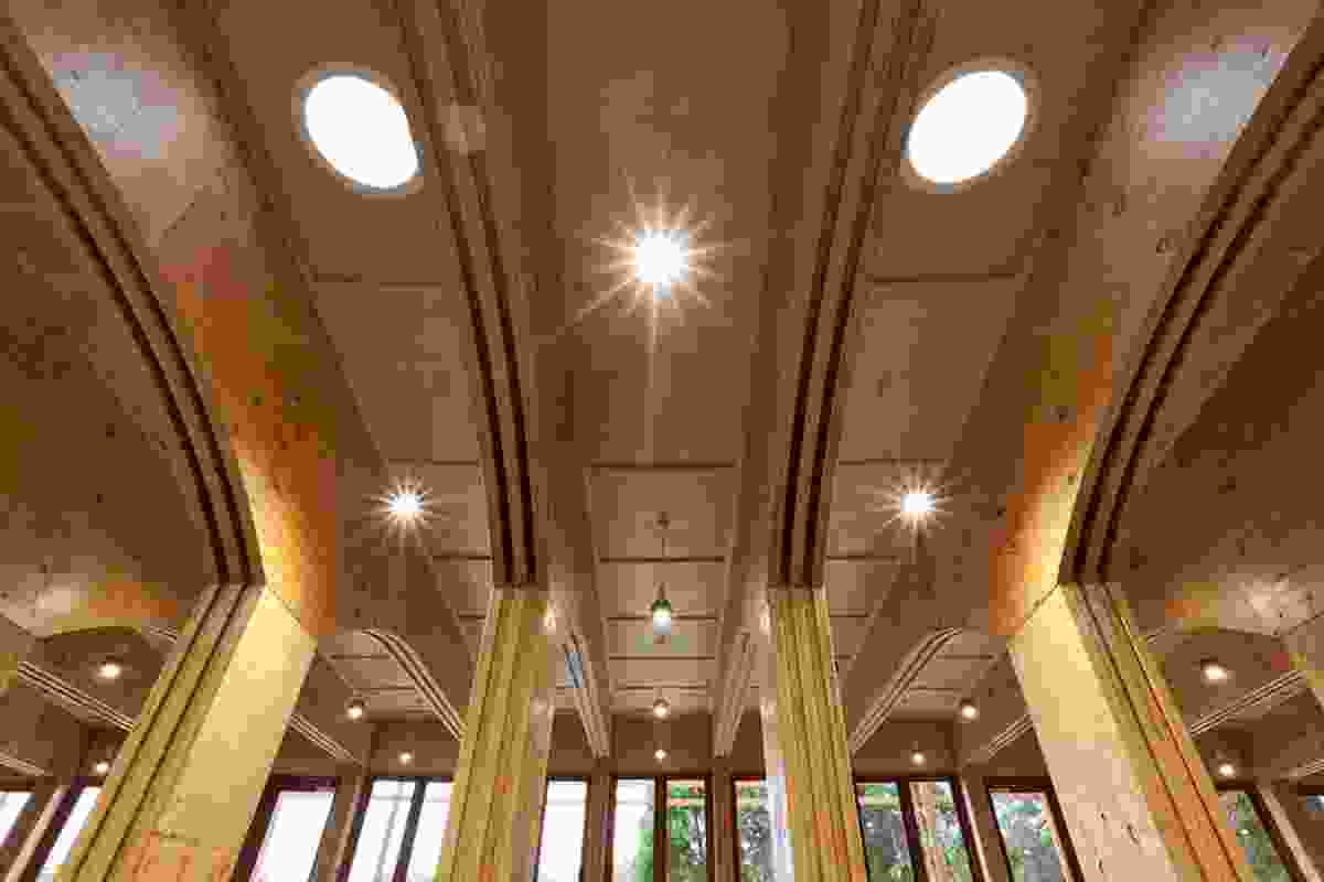Ribbed screw laminated LVL portals and hoop pine plywood linings give shape to the dramatic ceiling.