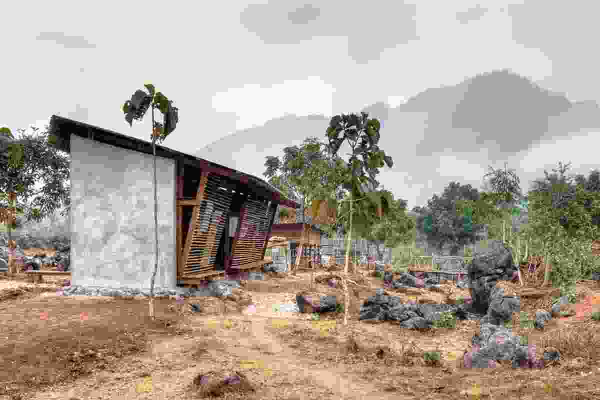 TYIN tegnestue Architects, Safe Haven Library: the area in front of the library is used to collect water in the rainy season.