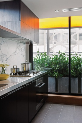 Stainless steel and Arabescato stone benchtops complement American oak timber veneer joinery.