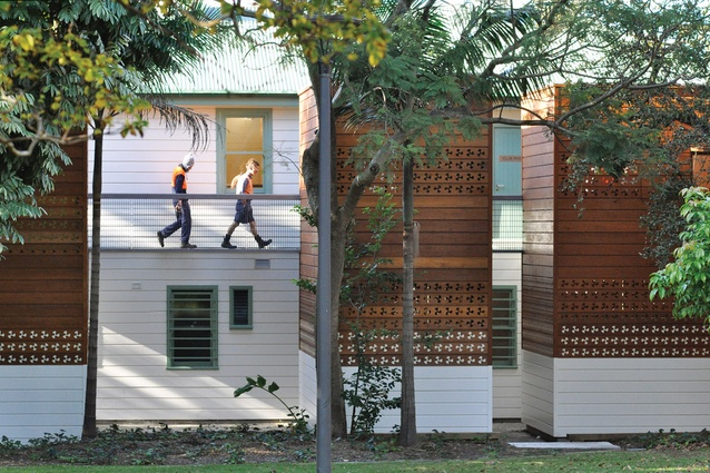 The weatherboard profile and height of the extensions mirror the original structure.
