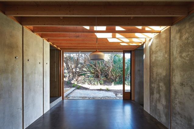 "A play on the nine-square grid allows an open bay to run centrally through the house, providing a ""common space"" that can open to the elements at each end."