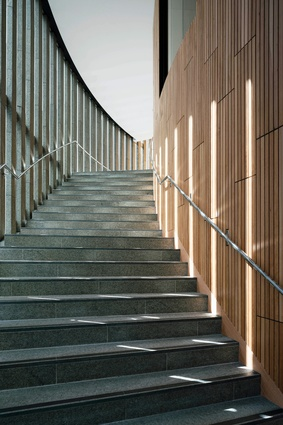 Connecting all levels of the library is a curved stair that wraps around the outside of the building.