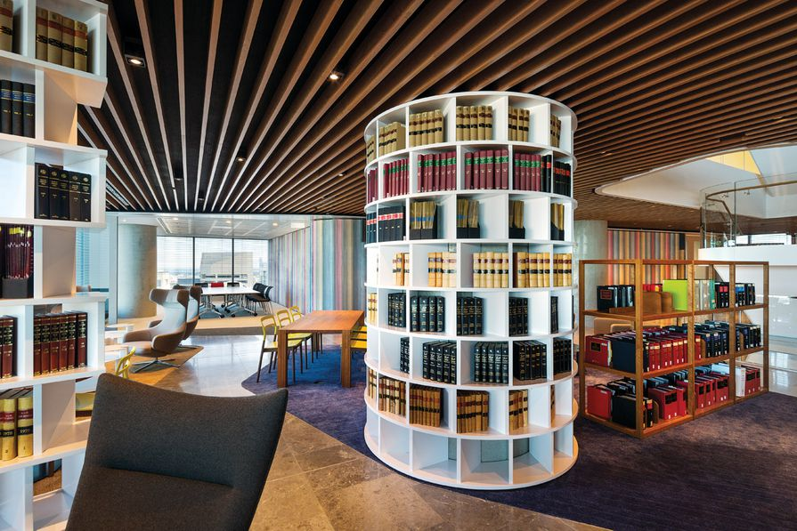 The colourful staff level has walls upholstered in missoni fabric and shelves of books.