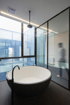 Circular motifs are dotted throughout Void House, such as in the bathtub, showerhead and cellar.