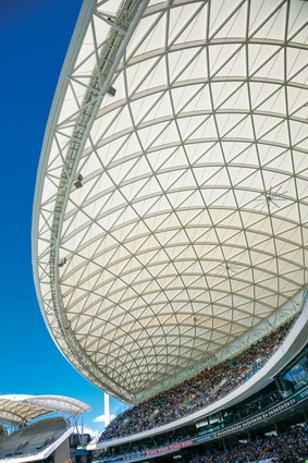Scalloped, diagrid roofs cover the stands and provide relief from the elements.