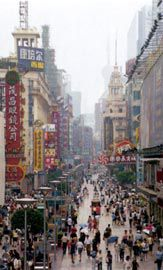 Nanjing Donglu (Nanjing Road East), one of the main shopping streets, looking towards the Pudong New Area.