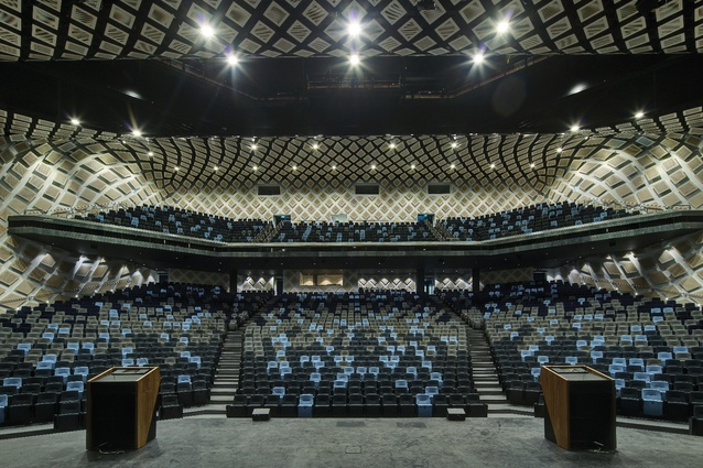 Housed within the ICC Sydney Convention Centre, the Darling Harbour Theatre features acoustic panels arranged in a wave-like pattern.