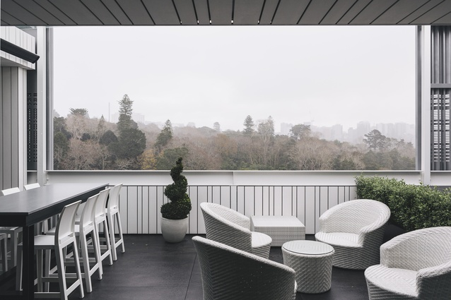 While there is no garden in this inner-city apartment, the outlook from the deck frames a landscape of beautiful, old trees in Auckland's Domain.