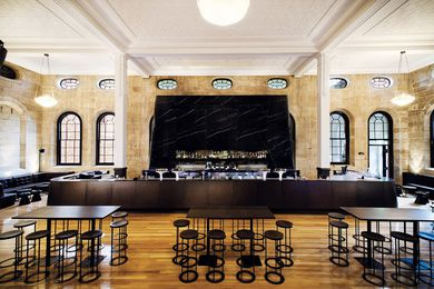 The main bar in black marble makes a brooding counterpoint to the restored sandstone.