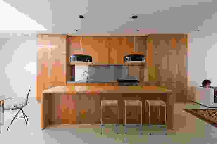 Full-height Tasmanian oak cabinets create a minimalist aesthetic.