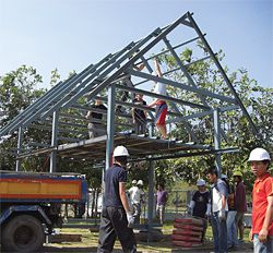 Students work with Dr David O'Brien to build a prototype sala in Nang Rong district, north-eastern Thailand. Photograph Hamish Hill.