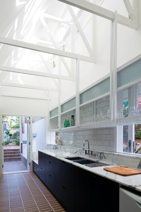 """The quality of light within the kitchen is created  via a roof """"snorkel."""""""