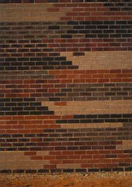 The brick patterning of the south facade indexes the manual processes of bricklaying. Image: Robert Frith
