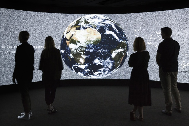 Exit is an immersive installation that employs a 360-degree animated global map.