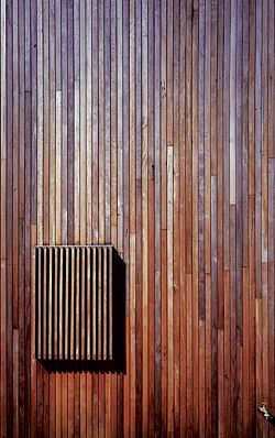 "Detail of the ""shimmering timber veil"" of vertical spotted gum, which clads the house. Image: Brett Boardman"