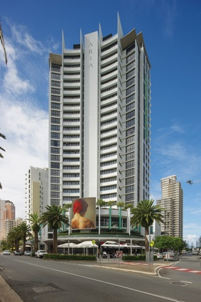 A monumental art board provides interest to the street corner at Aria (2002), Broadbeach, a mixed-use retail, home offices and apartments tower by Atelier SDG.