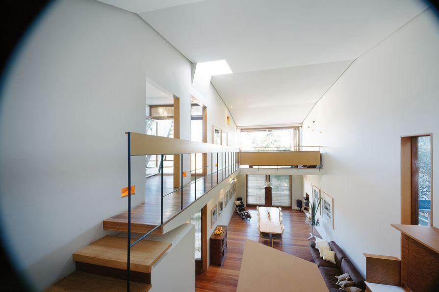 Although the house is small in footprint, the double-height space and connection between levels make it feel larger.