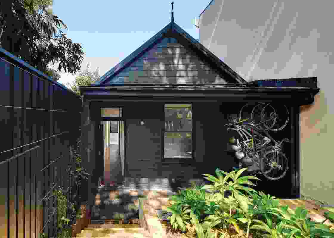 "The ""heritage"" weatherboard frontage has been painted black to suppress non-original details and materials."