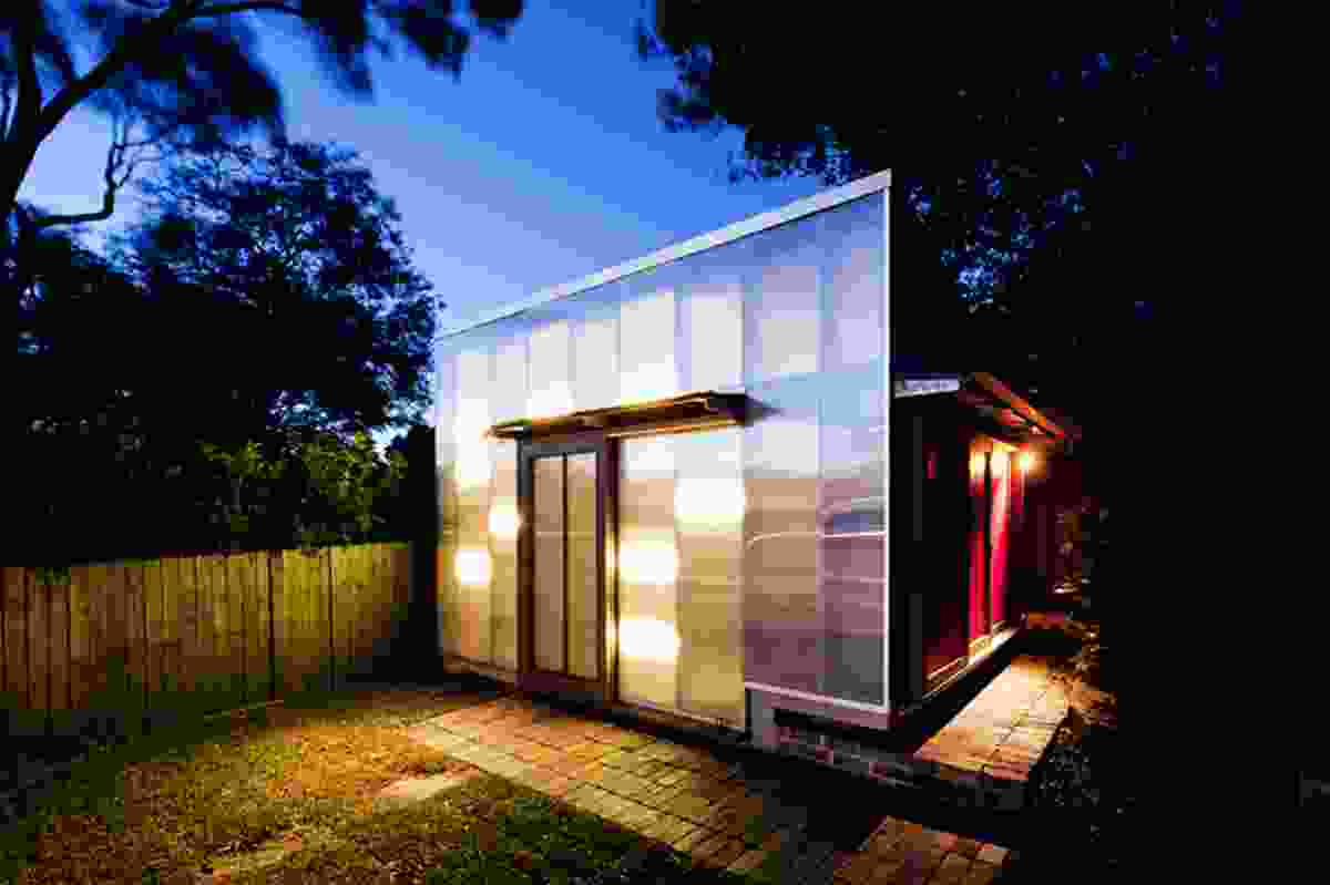 LED lights behind the polycarbonate cladding transform the studio into a lantern at night.