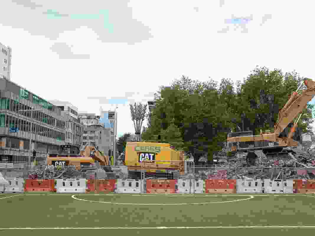 Football in the gap sits opposite the Ibis Hotel, a site formerly within the boundaries of the red zone. 'Flour power', a Regan Gentry sculpture, sits in the background like an oversized regional locator beacon.