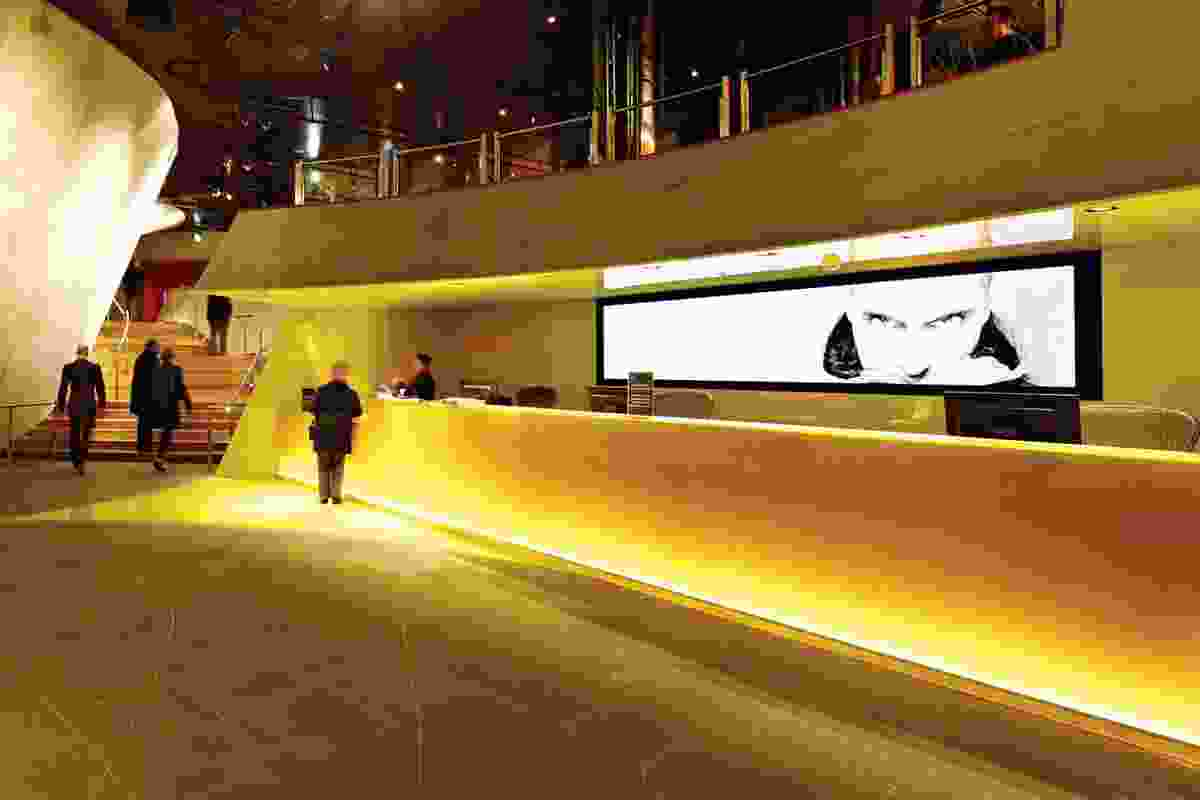 The new lobby adopts a glowing, yellow interior.