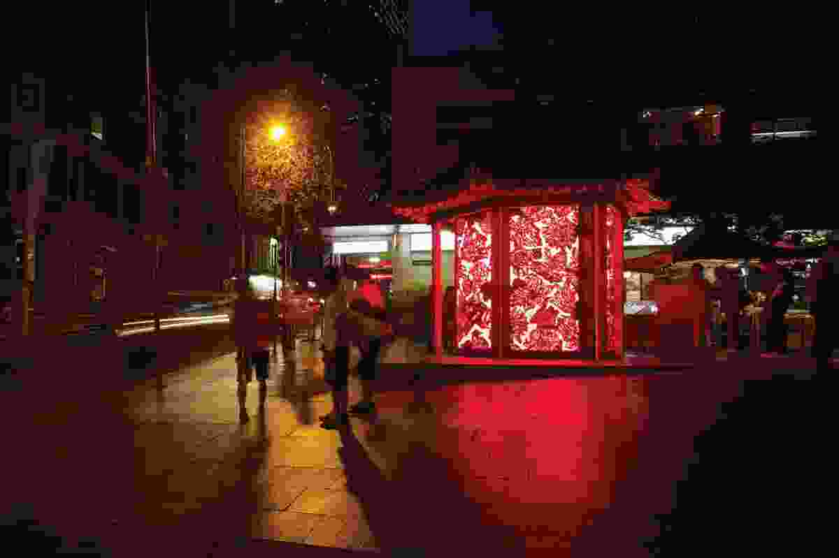 The lantern's glow lifts the atmosphere of the pedestrian mall.