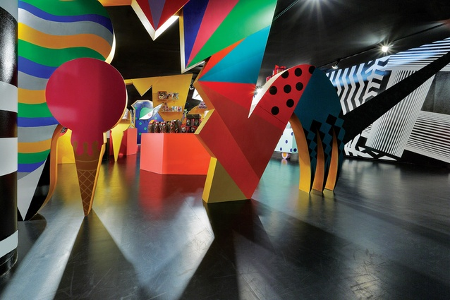 The colourful sculptures act as framing devices as well as displaying product.