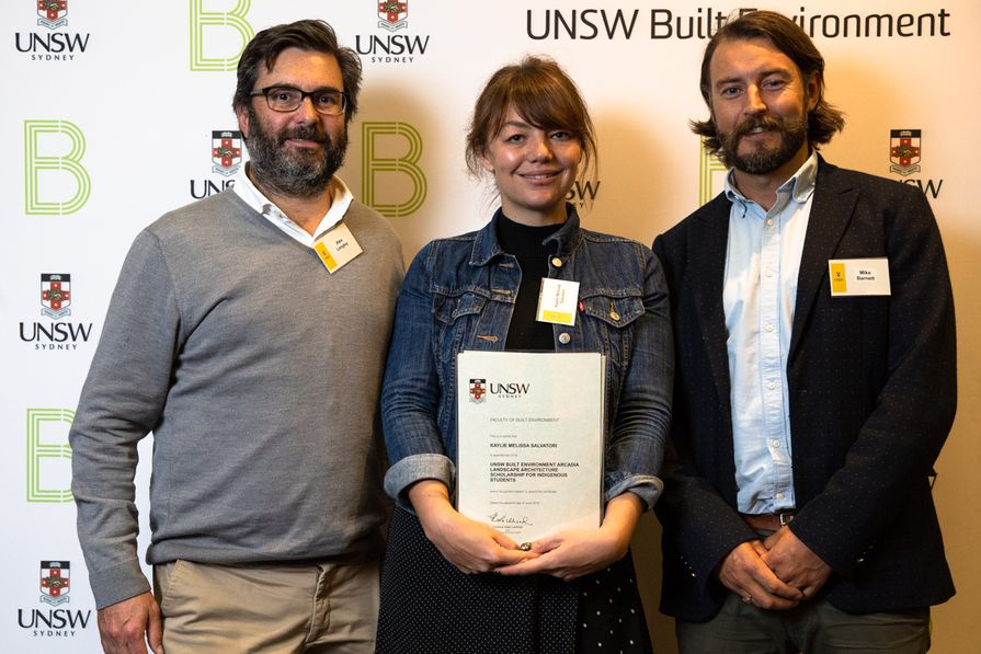 Arcadia principals Alex Longley and Michael Barnett present UNSW graduate Kaylie Salvatori with the Arcadia scholarship in 2019.