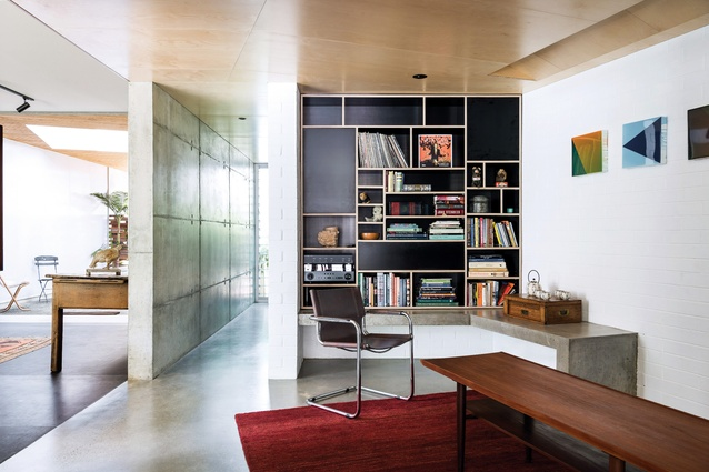 The house has been designed to accommodate the owners' collection of mid-century furniture. Artwork: Trevor Richards.