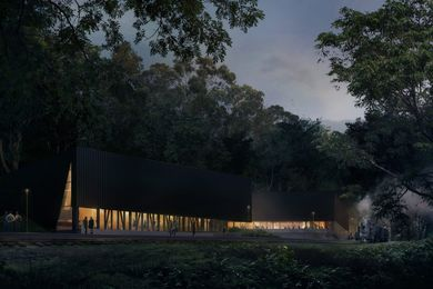 The Lakeside Discovery Centre by Terroir has a deep black exterior, echoing the locomotives of the railway and allowing the large building to recede into the shadows of the bush.