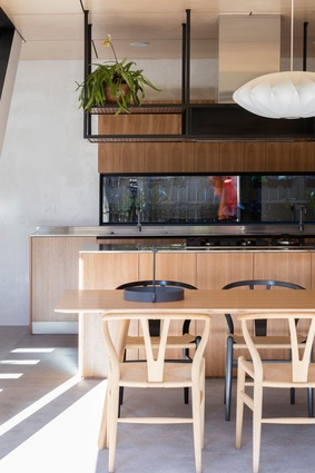 The side garden of Cricket Pitch House, featuring honey-coloured joinery and flooring, are efficient and visually refined.